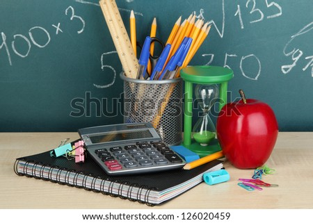 School supplies on wooden table - stock photo