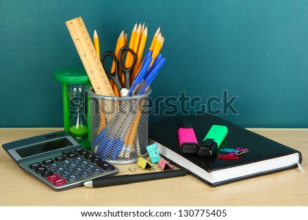 School supplies on wooden table - stock photo