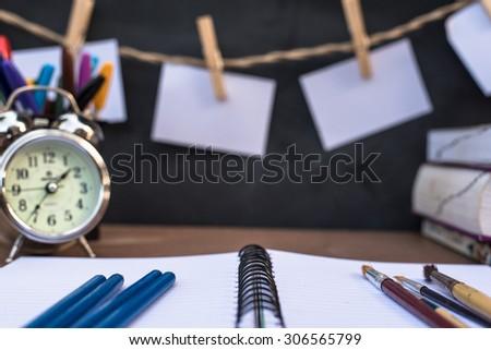 School supplies side border on a chalkboard background - stock photo