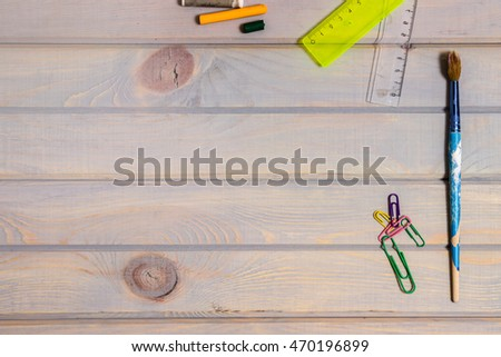 School supplies. Stationery on wooden background. Top view. Copy space.