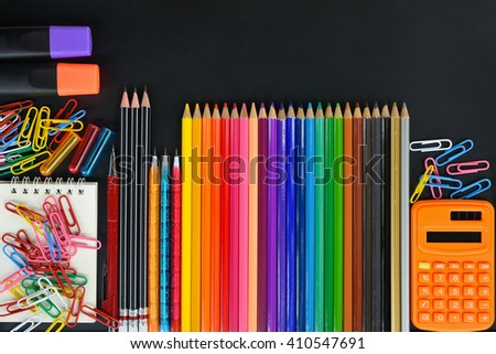 School supply on black background