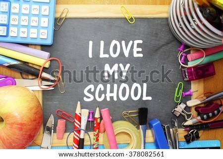 school supply on small blackboard with i love my school words - stock photo