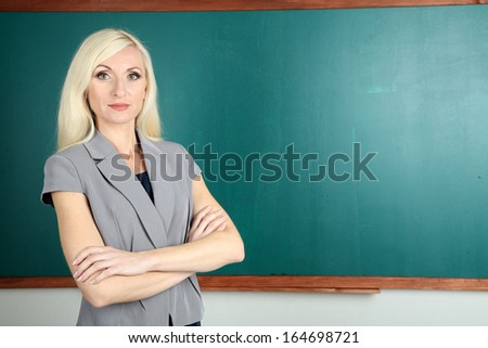 School teacher near blackboard close-up