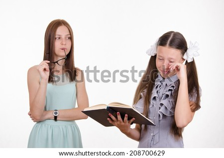 School teacher scolds the student who does not do their homework - stock photo