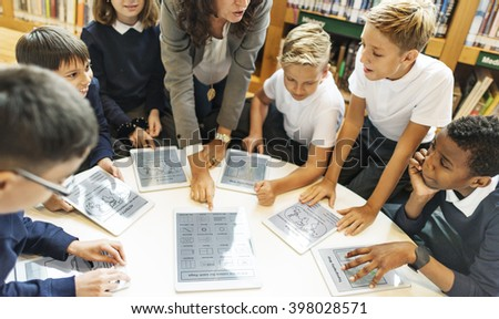School Teacher Teaching Students Learning Concept - stock photo