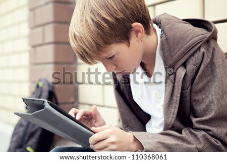 School teen with schoolbag and skateboard, day - stock photo
