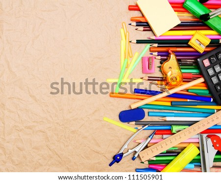 School tools on the rumpled paper.