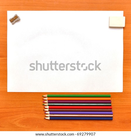 School tools on wooden board