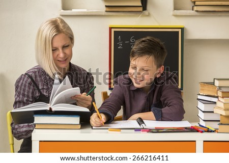 School tutor with young student. - stock photo
