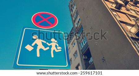 School warning street sign in the urban area - stock photo