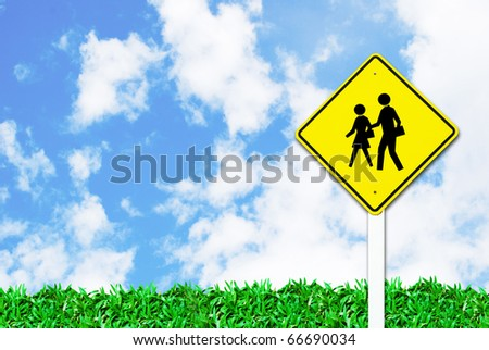 school warning traffic road sign on beautiful sky and grass field background - stock photo