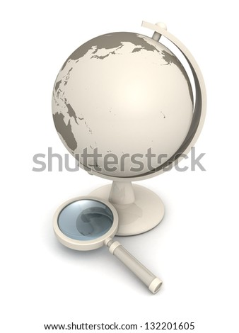 school world globe and a magnifying glass - stock photo
