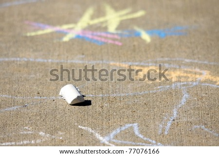 school yard sidewalk chalk drawings - stock photo