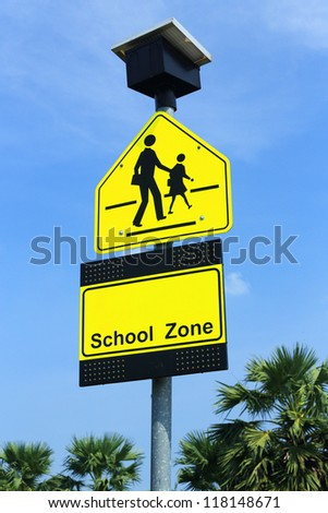 School zone sign, drive slowly and be careful student walking cross the road - stock photo