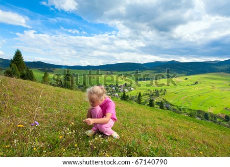 Schoolage girl in a summer mountain walk - stock photo