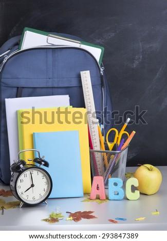 schoolbag and Service near the teacher's board - stock photo