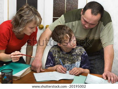 Schoolboy and parents - stock photo