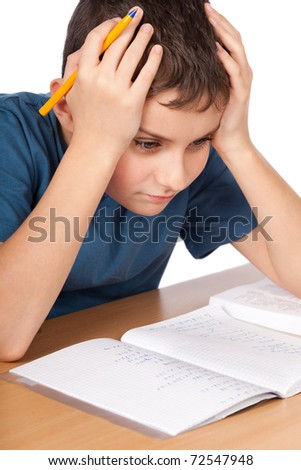 Schoolboy being stressed by his homework, isolated on white background - stock photo