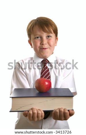 Schoolboy carrying a book with an apple on it for his teacher. Isolated on white. - stock photo