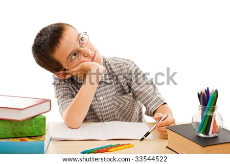 Schoolboy doing bored his homework - isolated - stock photo