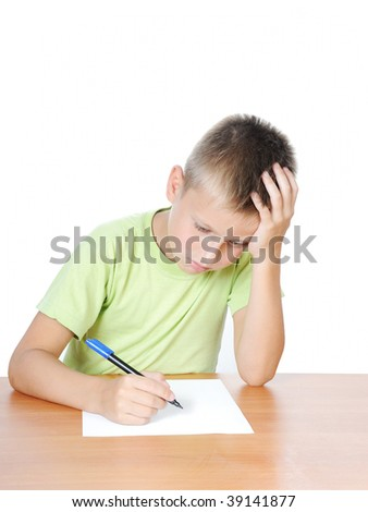 Schoolboy doing bored his homework on white bacground - stock photo
