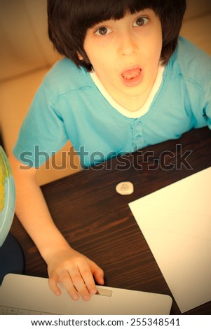schoolboy doing homework, portrait. Instagram image retro style - stock photo