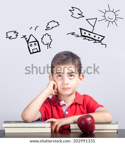 Schoolboy dreaming - stock photo