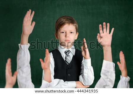 Schoolboy hand up. Pupils raising arms during the lesson, Education and school concept - stock photo