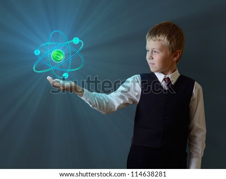 schoolboy holding glowing atom - stock photo