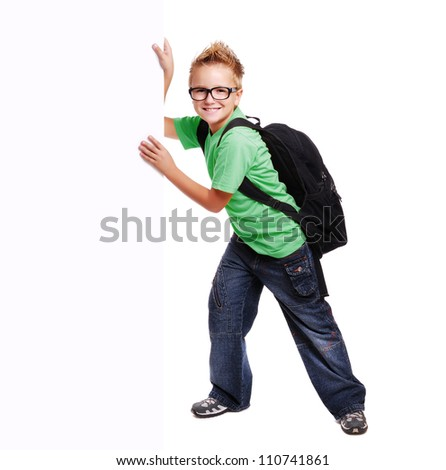 Schoolboy holding the blank board - stock photo