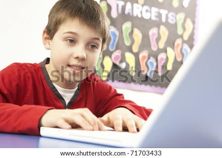 Schoolboy In IT Class Using Computer - stock photo