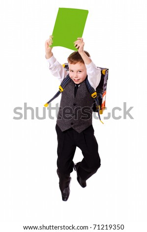 Schoolboy jumping holding book wearing backpack isolated - stock photo