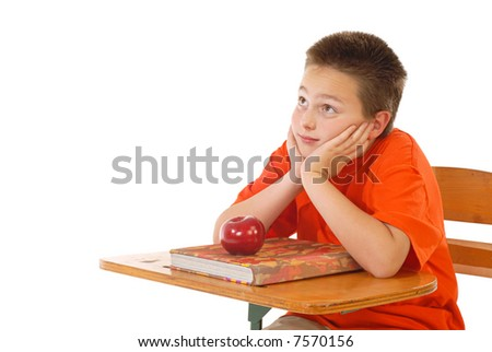 Schoolboy looking up at anticipation to hear teacher's instruction; isolated on white - stock photo