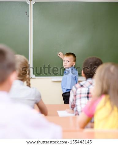 schoolboy near a school board - stock photo