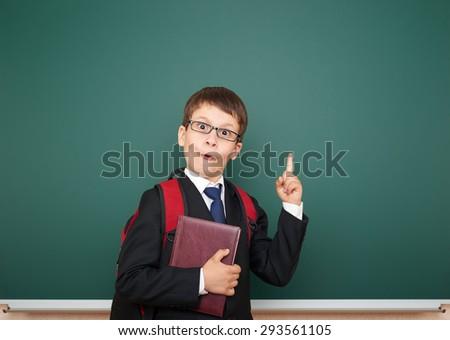 Schoolboy near the school board - stock photo