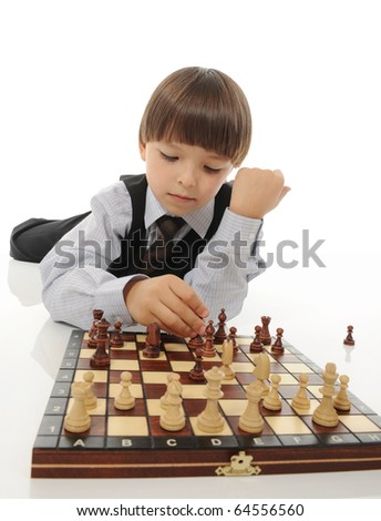 schoolboy playing chess