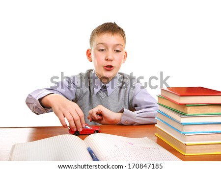 Schoolboy plays with a Toy on the School Desk on the white background - stock photo