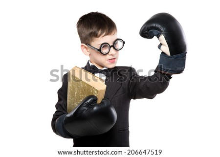 Schoolboy reading a book in boxing gloves and suit. School and education - stock photo