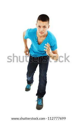 Schoolboy running - isolated over a white background