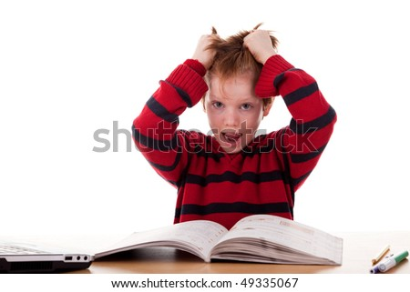 Schoolboy screaming and tearing his hair - stock photo