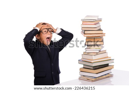 Schoolboy screaming near the huge stack of books isolated over white background - stock photo