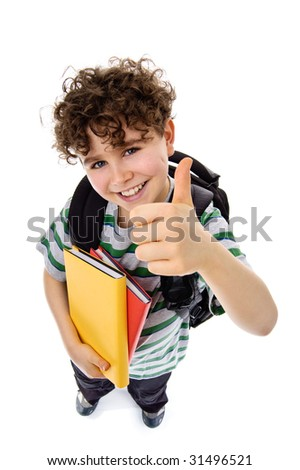 Schoolboy showing OK sign isolated on white