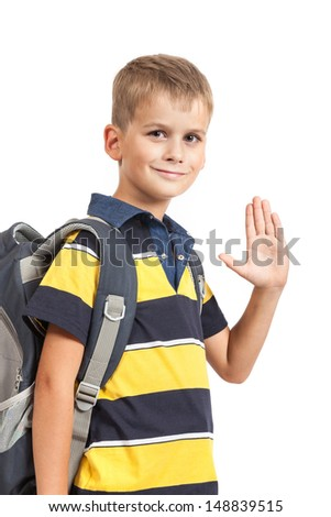 Schoolboy sitting on books isolated on a white background. Back to school - stock photo