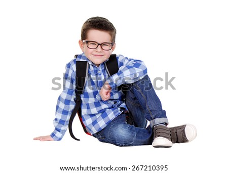 schoolboy sitting on the floor - stock photo
