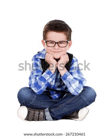 schoolboy sitting on the floor closeup portrait - stock photo