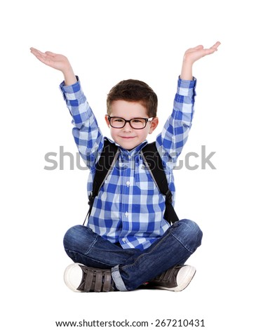schoolboy sitting on the floor  making holding gesture - stock photo