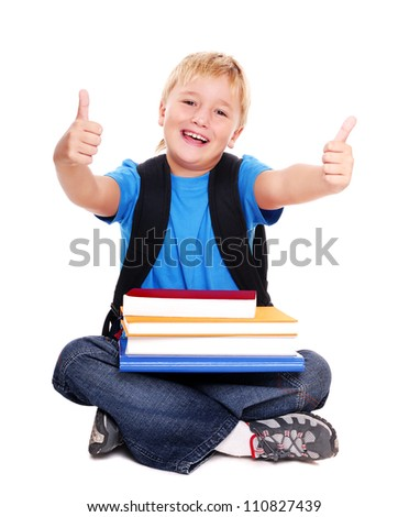 Schoolboy sitting on the floor showing thumbs up - stock photo