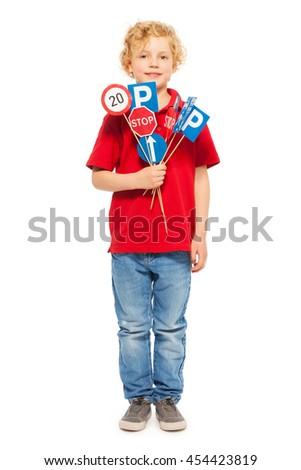 Schoolboy studying road traffic regulations - stock photo