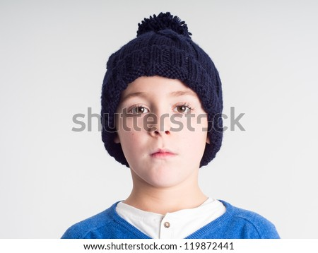 Schoolboy with a wool  bobble hat - stock photo