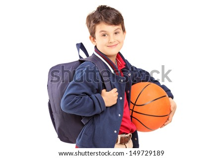 Schoolboy with backpack holding a basketball, isolated on white background - stock photo